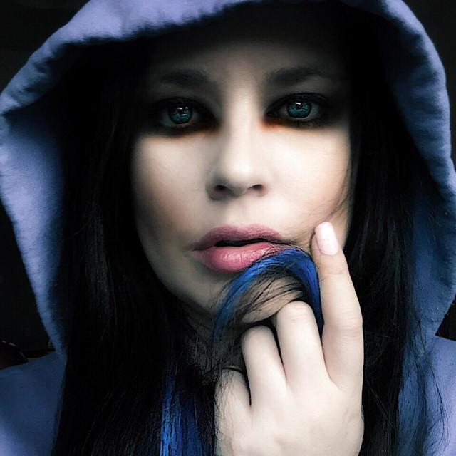 """Artist self portrait, woman in hoodie"" stock image"