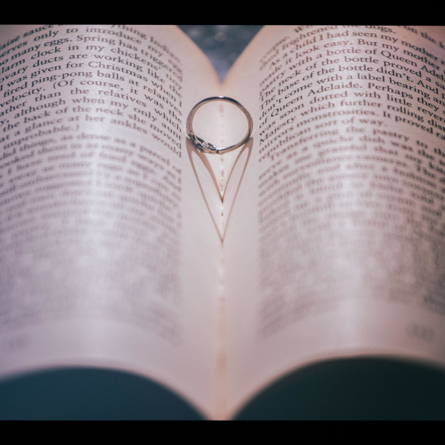 """Ring in book and heart shadow"" stock image"