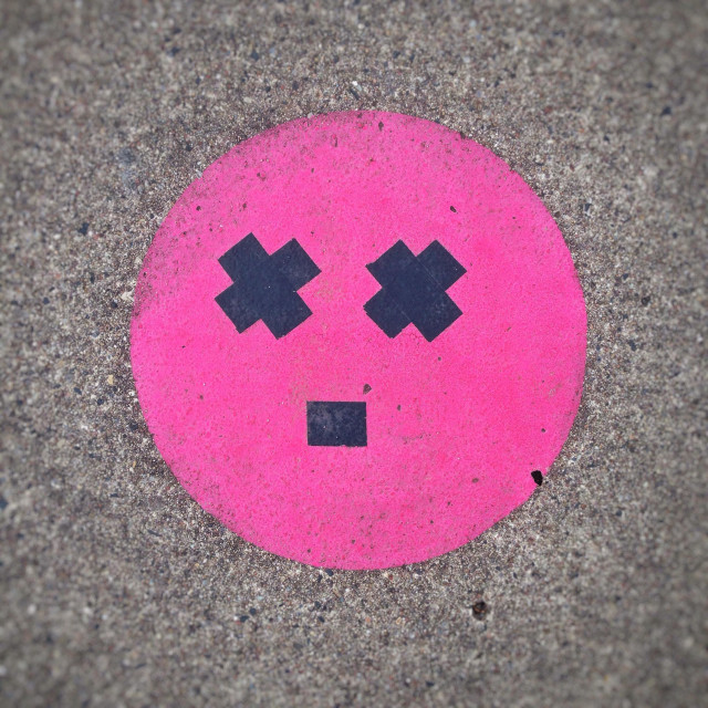 """""""Dizzy or astonished face smiley emoticon or emoji created on the pavement with duct tape"""" stock image"""