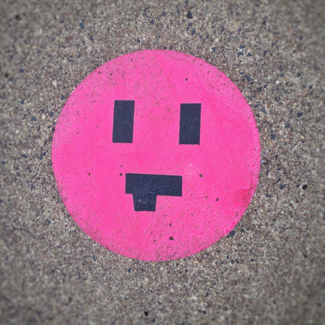 """""""Cheeky face with tongue stuck-out smiley emoticon or emoji created on the pavement with duct tape"""" stock image"""