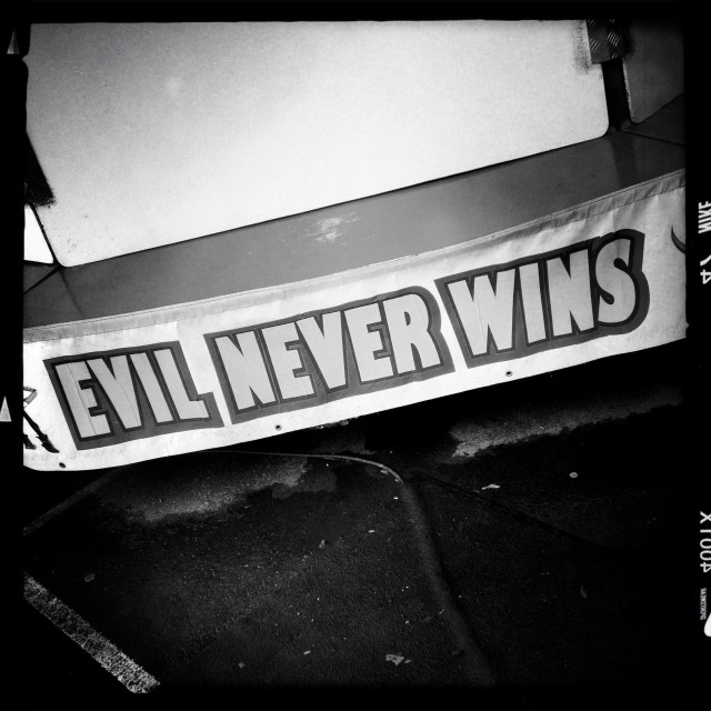 """""""Evil Never Wins sign"""" stock image"""
