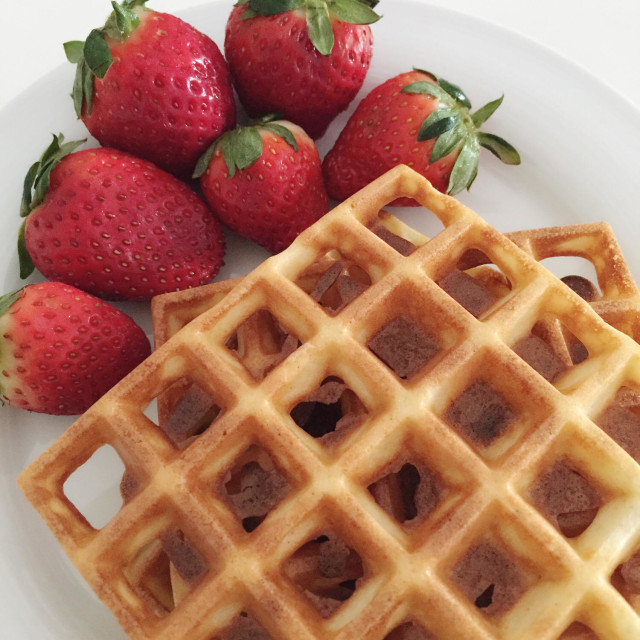 """""""Homemade waffles with strawberries."""" stock image"""