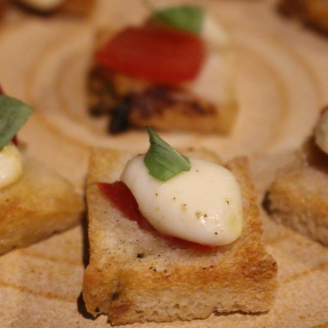 """Mediterranean canapés - crostini with mozzarella and tomato"" stock image"