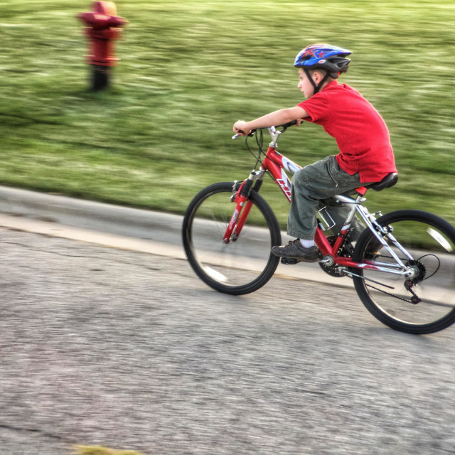 """""""Boy speeding past on a bicycle"""" stock image"""