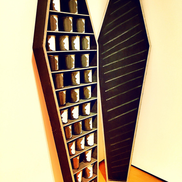 """Coffin and glass mug display in a museum"" stock image"