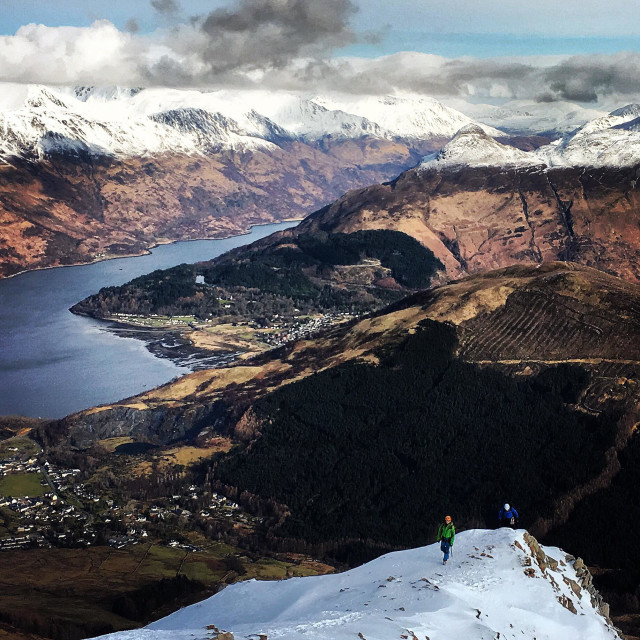 """Two climbers on School House arête above Ballachulish in Glencoe Scotland UK"" stock image"