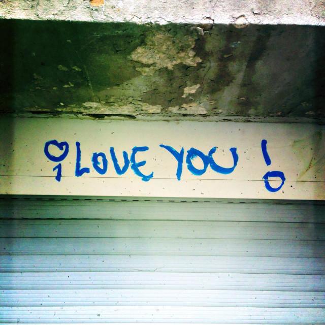 """I love you graffiti above a closed window"" stock image"