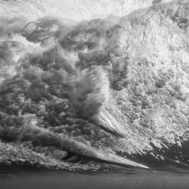 """""""Breaking wave with surfer from underwater"""" stock image"""