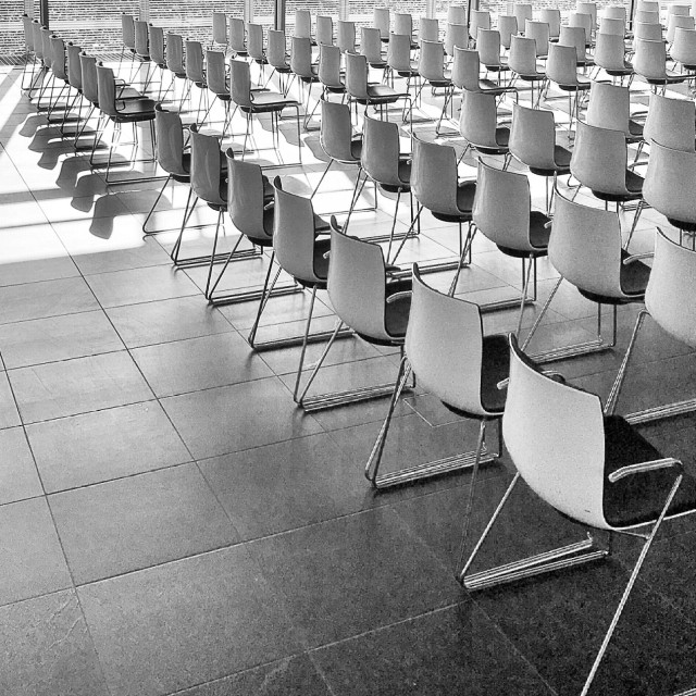 """""""Light on white chairs in the topography of terror in Berlin"""" stock image"""