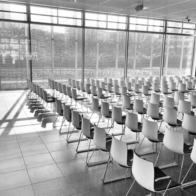 """""""Empty room with white chairs at topography of terror in Berlin"""" stock image"""