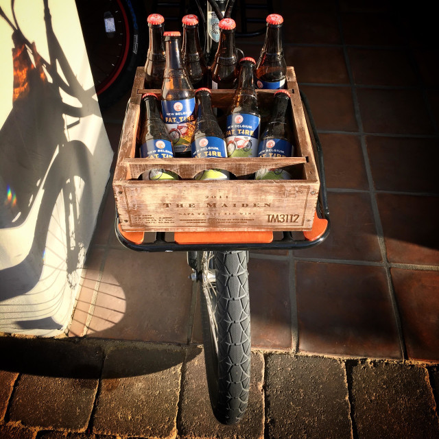 """""""A bicycle with a fat tire carrys a load of Fat Tire beer in Southern California USA"""" stock image"""