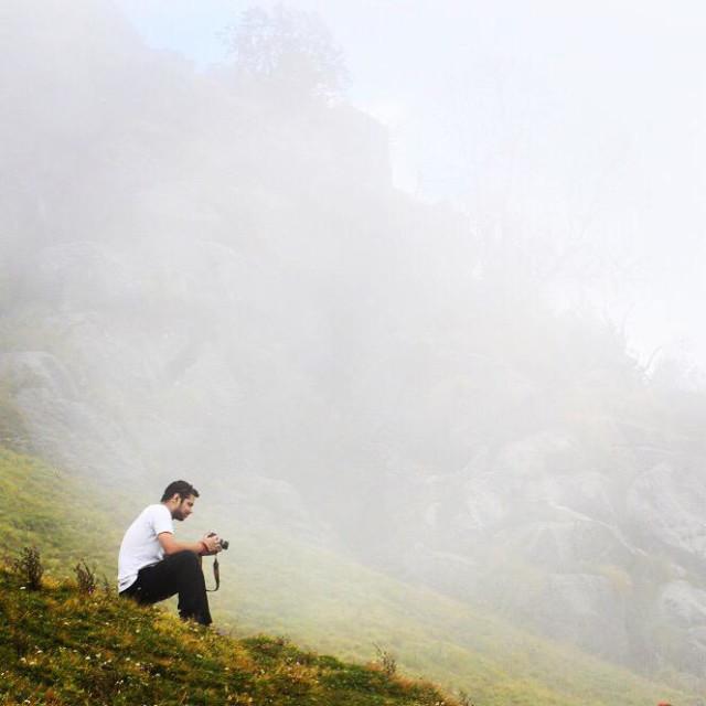 """A photographer taking photos at Khalia Top in Munsiyari, Uttarakhand, India."" stock image"