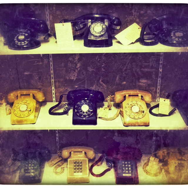 """All telephones for sale on a shelf in an antique store"" stock image"