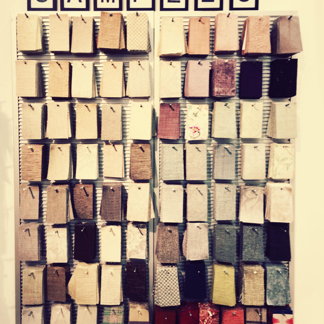 """""""Fabric samples hanging on a wall."""" stock image"""