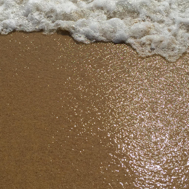 """Pattern wet sand on the beach and a wave breaking - Ios island Cyclades Greece"" stock image"