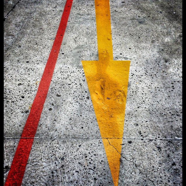 """""""Yellow arrow and red line on road."""" stock image"""