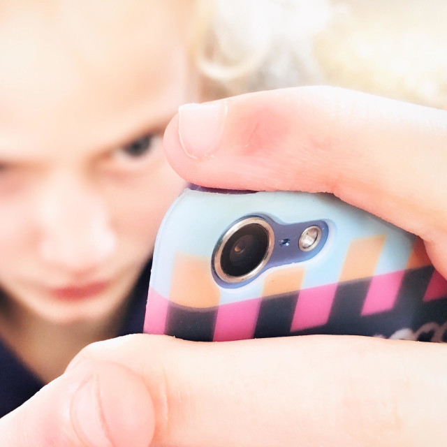 """""""Young girl concentrating on her iPod"""" stock image"""