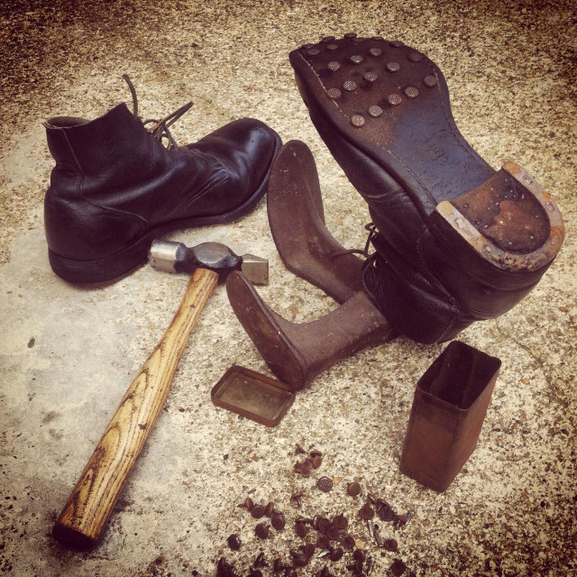 """""""Cobblers. Repairing my old ammo boots"""" stock image"""
