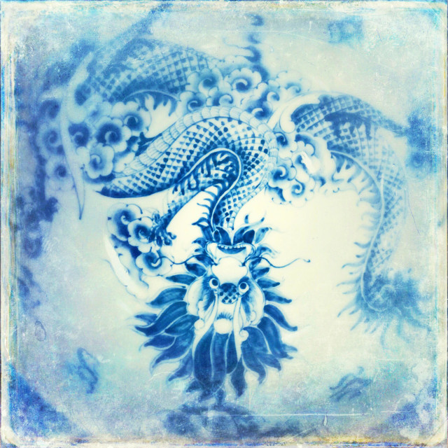 """A china plate with an image of a dragon"" stock image"