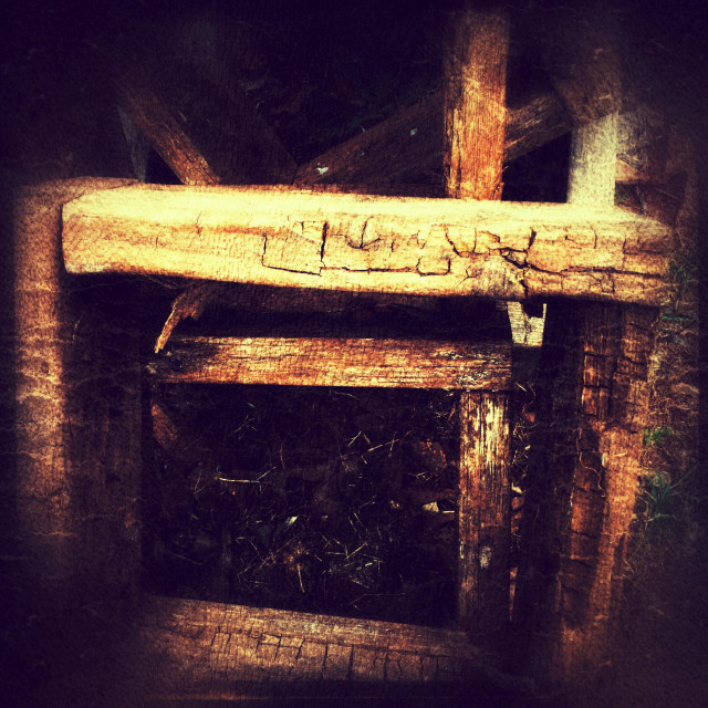 """""""Old wood nailed into squares taken with grunge film"""" stock image"""
