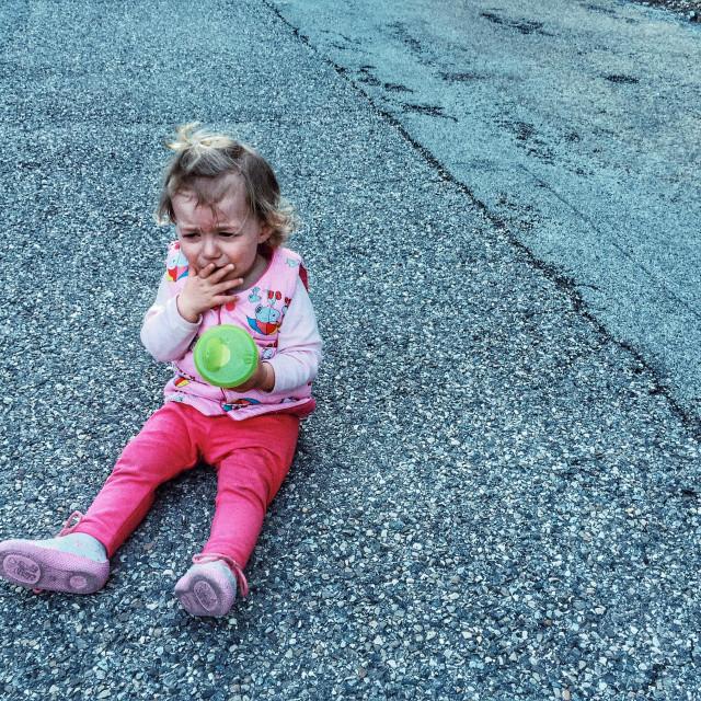 """Unhappy baby girl"" stock image"