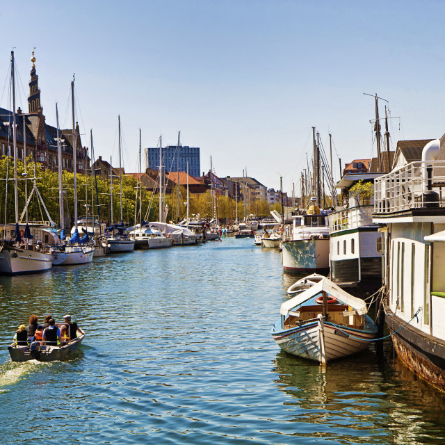 """Copenhagen, Denmark -Christianshavn main channel with boats moored"" stock image"