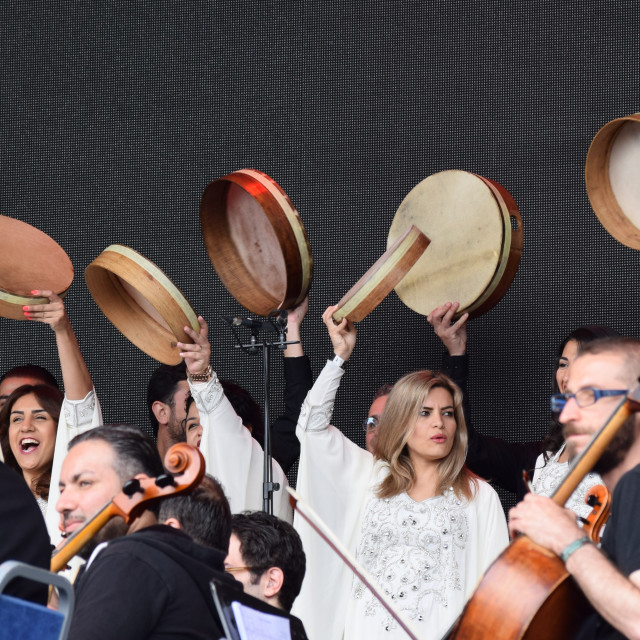 """""""The Orchestra of Syrian Musicians greet the Glastonbury Festival audience (June 2016)"""" stock image"""