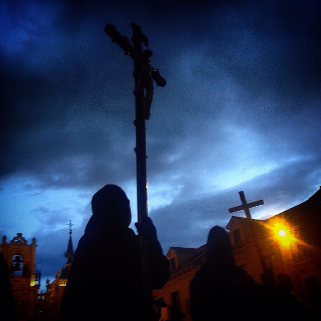 """""""A hooded penitent holds a crucifix during Easter Holy Week in Astorga, Maragateria, Leon, Spain"""" stock image"""