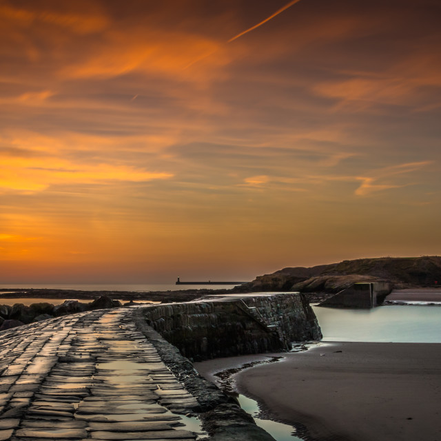"""Sunrise at Cullercoats Bay, North Tyneside, England"" stock image"