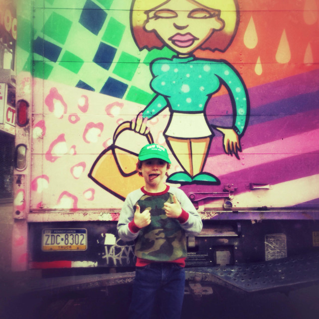 """Six year old boy next to a graffitied delivery truck, New York City, United States of America."" stock image"