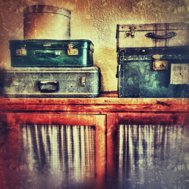 """""""Suitcases and a hat box on a cupboard"""" stock image"""