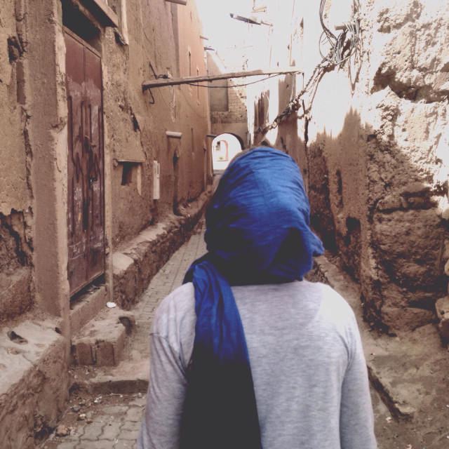 """Woman with headscarf in a Moroccan alley"" stock image"