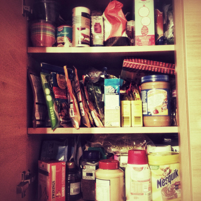 """""""A kitchen cupboard full of food."""" stock image"""