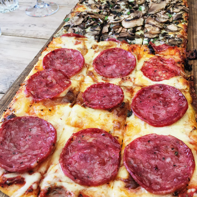 """Pizza in a wooden slab"" stock image"