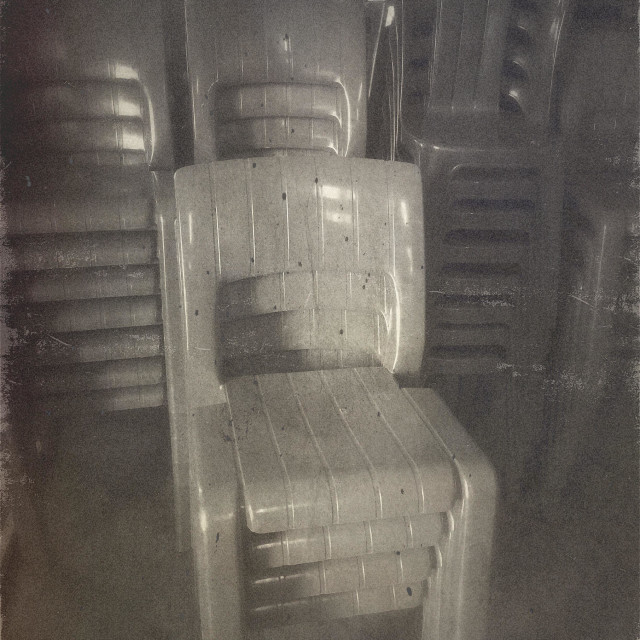 """""""Stacked plastic chairs."""" stock image"""
