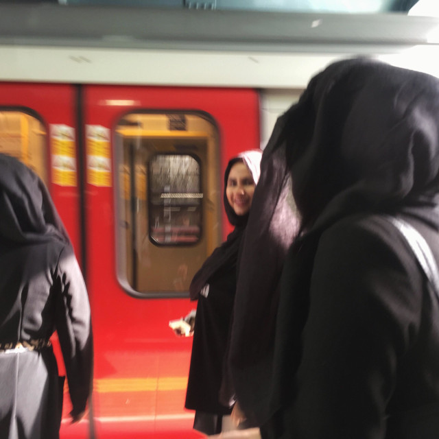 """Muslim women in hijab, burka or Niqab at Whitechapel station, London, U.K"" stock image"