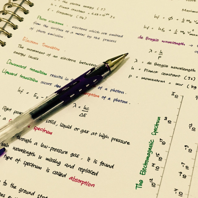 """""""Physics note written in colourful handwriting, with a pen on the paper."""" stock image"""