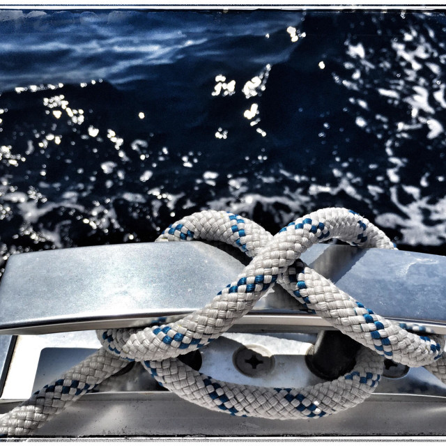 """""""Cleat on a sailing yacht with rope fastened in a figure of eight"""" stock image"""