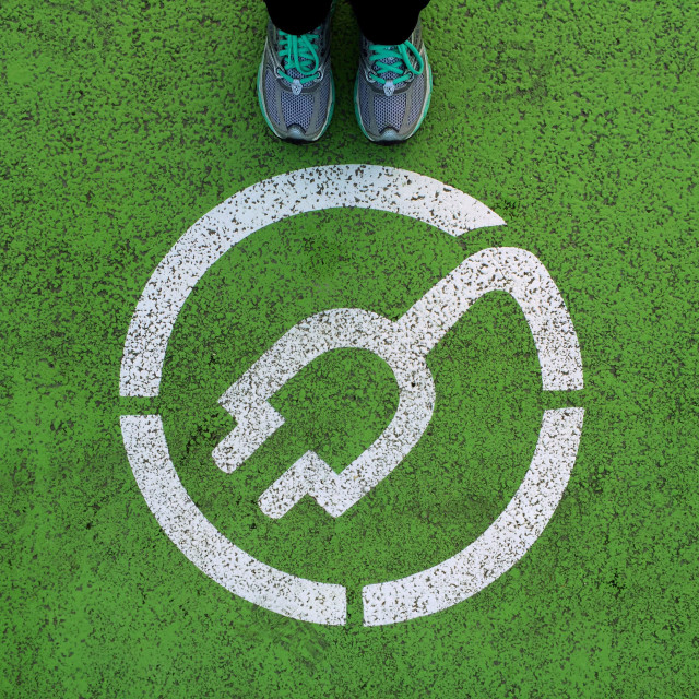 """""""Standing next to electric car recharging point sign"""" stock image"""