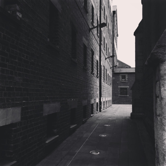 """""""An old industrial passageway on the docks in Gloucester"""" stock image"""