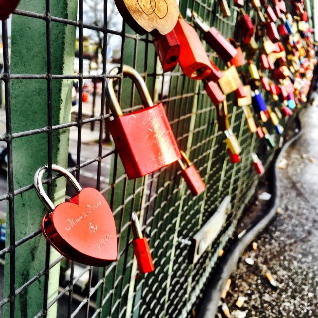 """Love locks secured to the railings of an overhead bridge in Hamburg, Germany"" stock image"