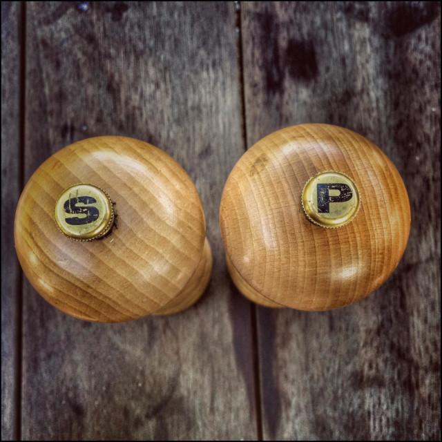 """Wooden salt and pepper grinders."" stock image"