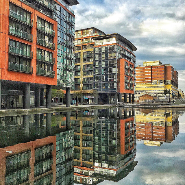 """""""Paddington Basin, a regenerated area of London next to Paddington station on the Grand Junction Canal. The building in the background is St Mary's Hospital where the royal babies are born."""" stock image"""