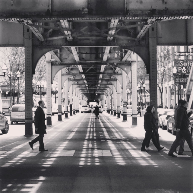 """Pedestrians walk beneath elevated train tracks in Chicago"" stock image"