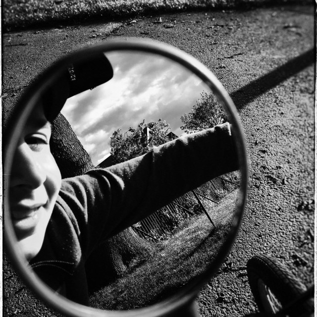 """Young boy on bicycle"" stock image"