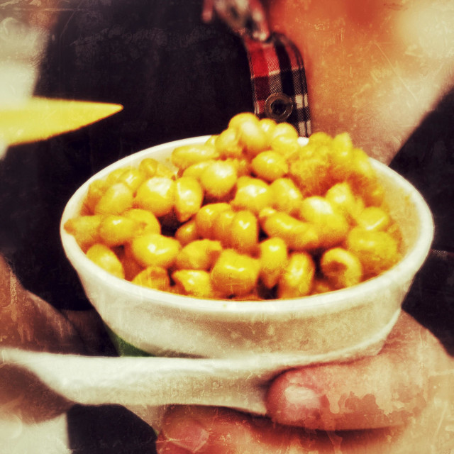 """""""Eating a cup of sweetcorn as a healthy snack."""" stock image"""