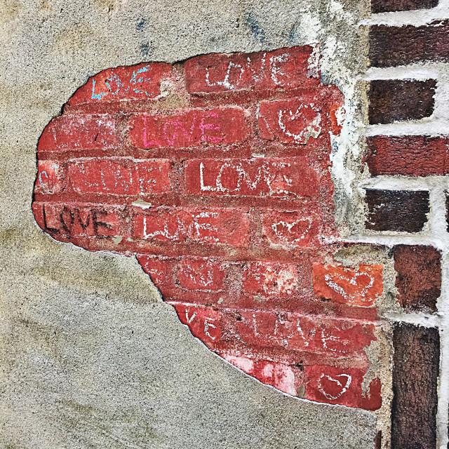 """Love Graffiti in Chalk on Brick"" stock image"