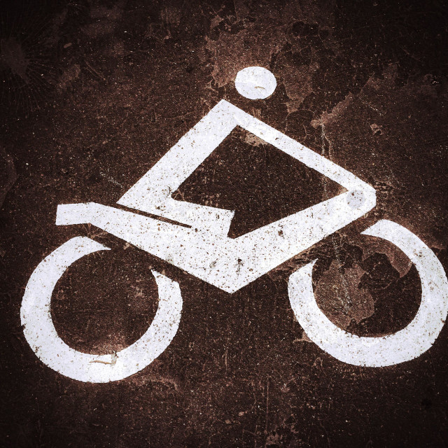 """A Motorcycle Logo identifying an area specifically designated for the parking of Motorcycles or Motorbikes. A grunge and vignette effect added for visual interest. Photo Credit - © COLIN HOSKINS."" stock image"