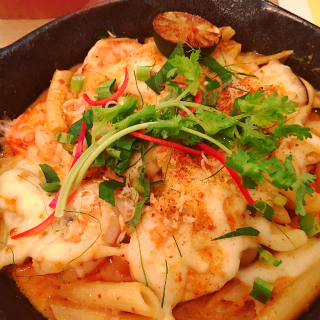 """""""Tom Yum Kung Penne, spicy Thai fusion food"""" stock image"""