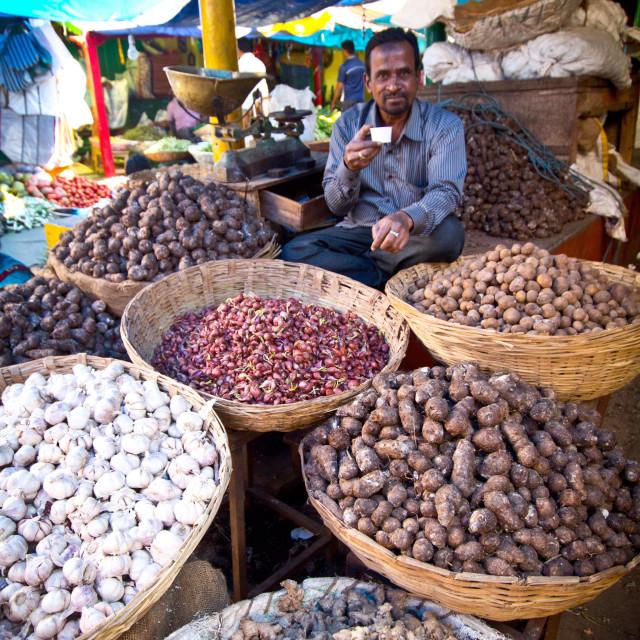 """Man drinking masala tea at Indian market"" stock image"
